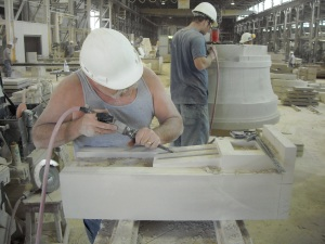 Two craftsman hand carve limestone