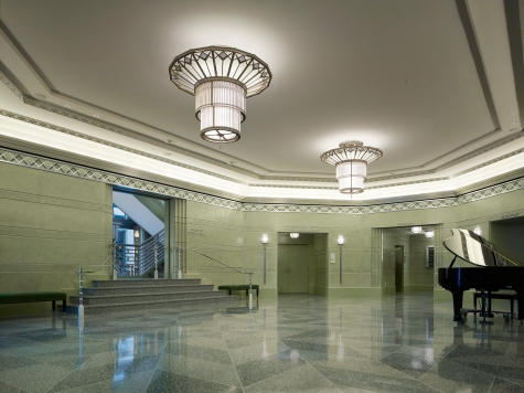 The Main Lobby in Boman Pavilion at The Smith Center for the Performing Arts features light fixtures which