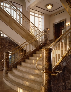 The grand staircase at The Schermerhorn features imperador light and XXX stones.