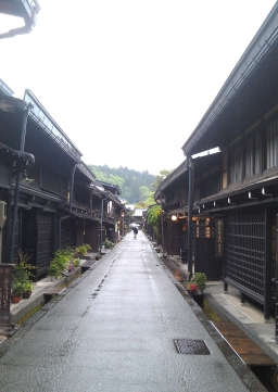 Ash-covered wooden shopfronts in Takayama, Japan