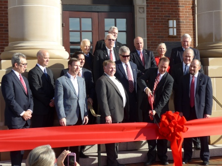 The ribbon being cut, marking the official opening of the new Alpharetta City Hall
